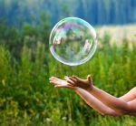 7457020-hand-catching-a-soap-bubble