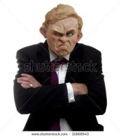 stock-photo-a-plasticine-modeling-clay-model-of-a-cross-or-grumpy-man-with-arms-crossed-wearing-a-suit-31669543